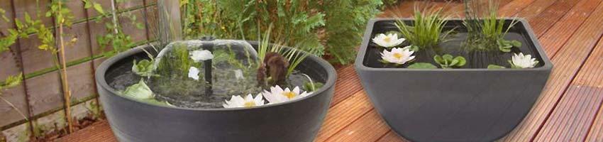 zwei Terrassenteiche mit Pflanzen und Springbrunnen
